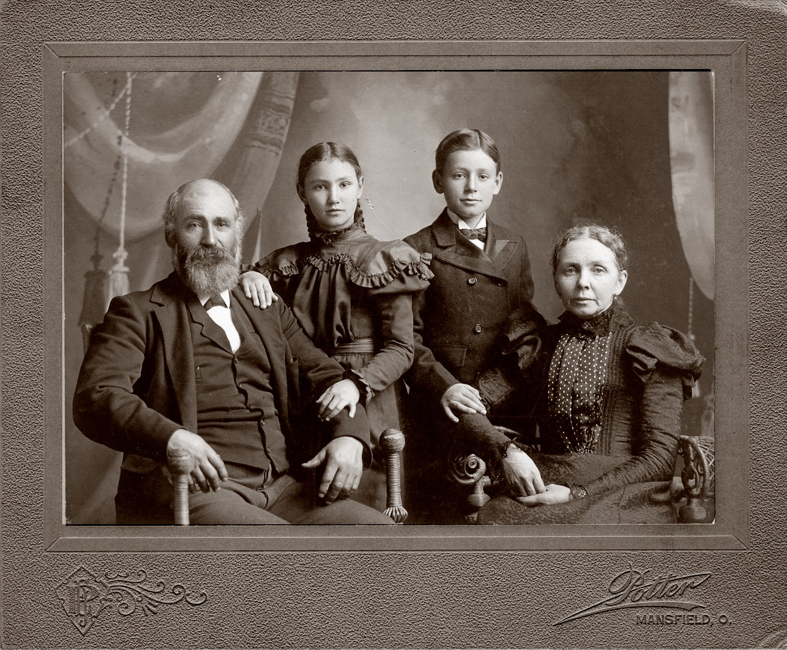 My great, great grandparents along with my great grandfather and his sister.