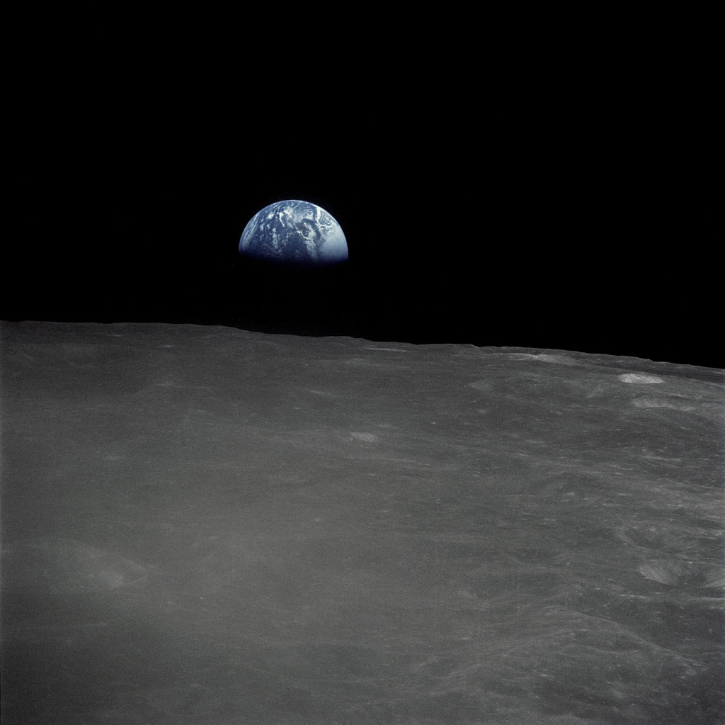 The Apollo 16 crew captured this Earthrise with a handheld Hasselblad camera during the second revolution of the moon. Identifiable craters seen on the moon include Saha, Wyld and Saenger. Much of the terrain seen here is never visible from the Earth, as the command module was passing over the far side of the moon. Apollo 16 launched on April 16, 1972 and landed on the moon on April 20. The mission was commanded by John Young; Thomas K. Mattingly II was the command module pilot and Charles M. Duke, Jr. served as the lunar module pilot. Image: NASA