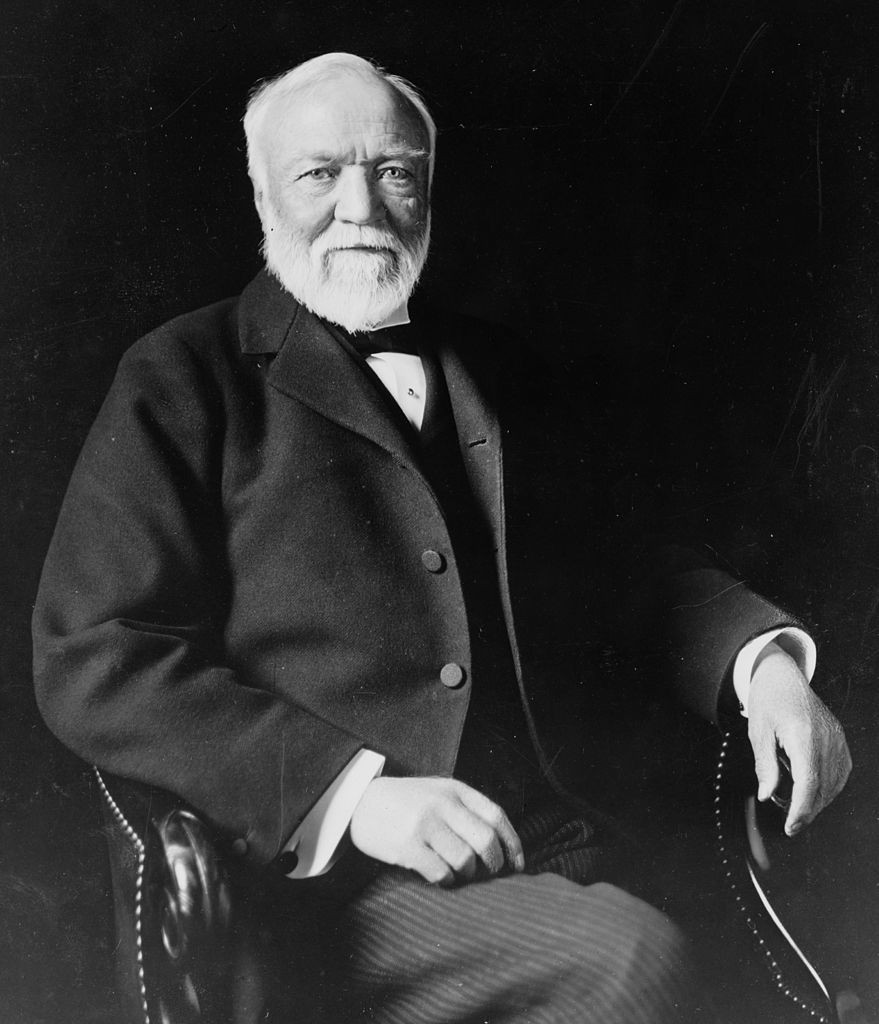 879px-Andrew_Carnegie,_three-quarter_length_portrait,_seated,_facing_slightly_left,_1913 PD
