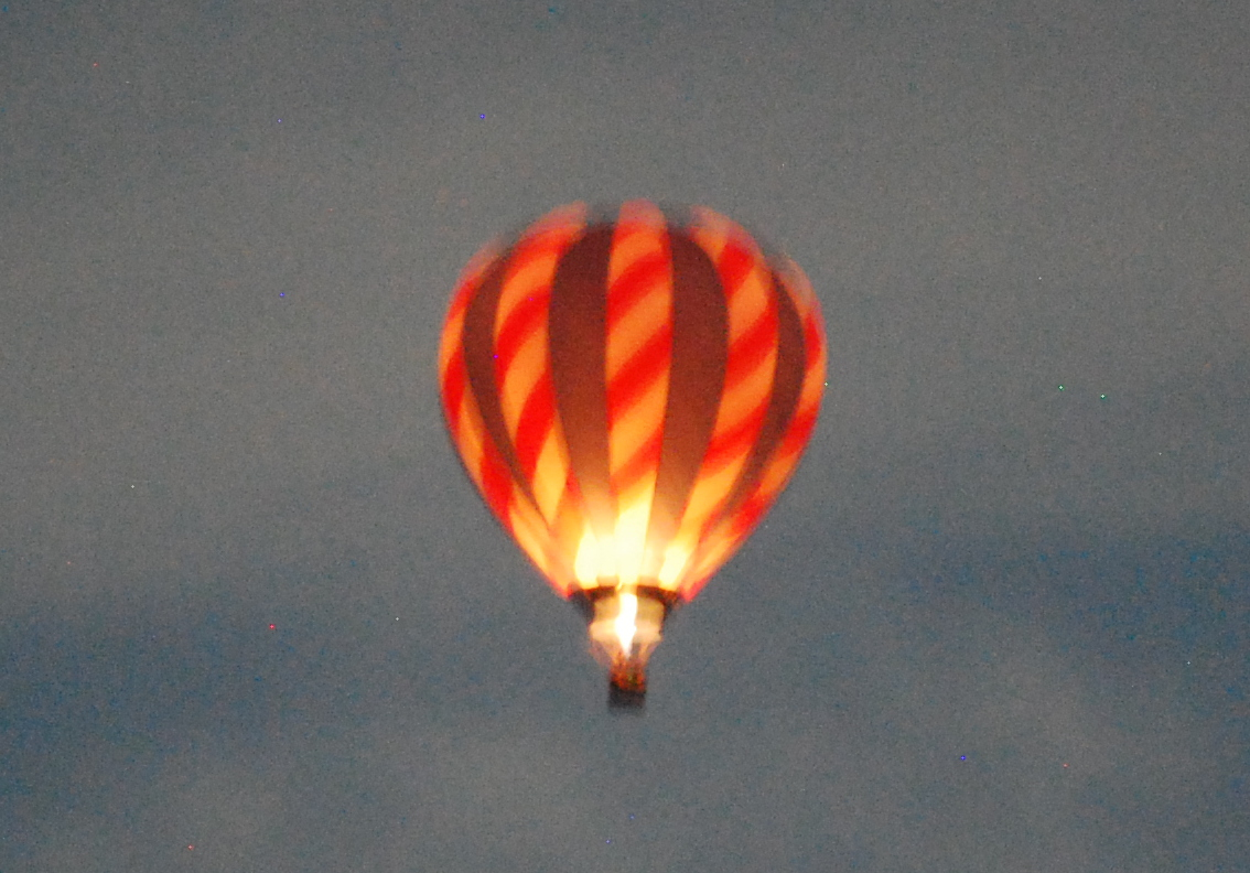 The hot air balloon, all lit up. And blurry. Photo: Jenny Bristol
